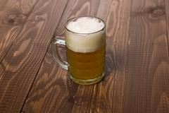 Frothy beer - stock photo