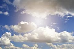 White fluffy clouds in the blue sky. - stock photo