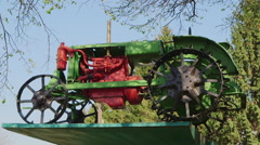 The old tractor on a pedestal - a monument to the tractor Stock Footage