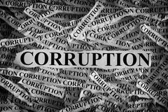 Torn pieces of paper with the word Corruption - stock photo