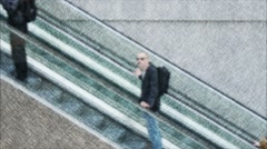 Shoppers using escalator in Shopping Mall Stock Footage