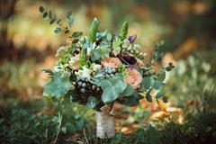 Bride's Bouquet on Green Grass - stock photo