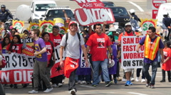 $15.00 per hour crowd of protesters in the street in San Diego Stock Footage