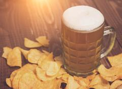 Beer and chips all around - stock photo