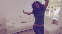 Camera moving from feet to closeup of Happy beautiful girl dancing at home 4K Arkistovideo