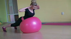 Instructor in sportswear doing deflection back exercises with fitball 4k Stock Footage