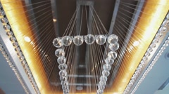 Gorgeous large chandelier in the hotel lobby Stock Footage
