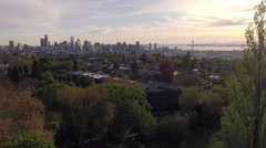 Amazing Aerial of Seattle Washington Flying by Trees to Reveal Downtown City Stock Footage