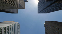 New York City skyscraper corporate buildings driving moving tracking low angle Stock Footage