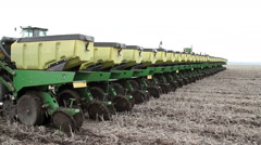 Tractor and seed drill are used to sow the sunflower Stock Footage