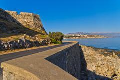 Coastal road below old fortress at Rethymno, Crete Stock Photos