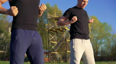 Training a Wing Chun between master and follower outdoor. 4k Stock Footage