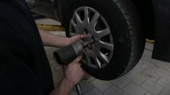 Releasing screws using pneumatic screwdriver - stock footage