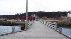 Pier at fjord of northern Norway. Garages for boats. Stock Footage