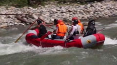 Group of six people white water rafting - stock footage