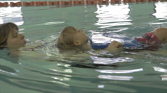 Little Boy Getting Swimming Lessons At Pool Stock Footage
