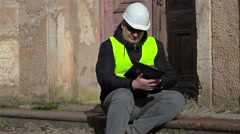 Building inspector sitting and checking documentation at the old manor Stock Footage