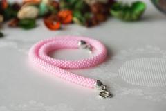 Handmade crocheted necklace made from pink beads Stock Photos
