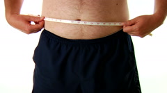 Over Weight White Male Measuring Belly Stock Footage