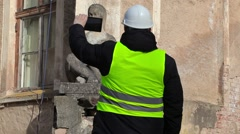 Scientist filmed on the tablet PC old monument before the restoration - stock footage