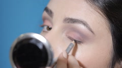 17to apply eyeliner - stock footage