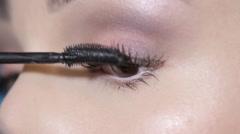21apply mascara on the eyelashes - stock footage
