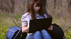 Woman resting sitting at a computer Stock Footage