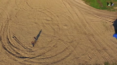Aerial view of fighting a Wing Chun  on a sand between men - stock footage