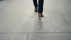 Walking on concrete : close-up view of man's leather shoes Stock Footage