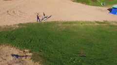 Aerial view of Wing Chun  on a sand between  strong men - stock footage