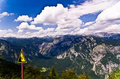Warning free fall ahead at mountain Vogel,Triglav national park,slovenian alps - stock photo