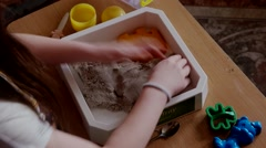 A Cute Little Girl Play With Kinetic Sand Stock Footage