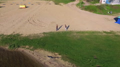 Aerial view of Wing Chun  on a sand between two strong men - stock footage