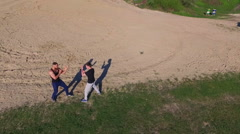 Aerial view of Wing Chun  on a coast between strong men Stock Footage