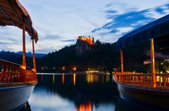 Silent summer evening and the boats on lake Bled in slovenian alps, Slovenia - stock photo