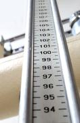 long measuring rod for measuring the height in an ancient scale - stock photo
