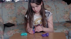 Cute Little Girl Play With Plasticine Stock Footage