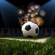 Soccer ball on the green field Stock Photos