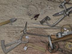 Vintage jeweler tools over wooden bench Stock Photos