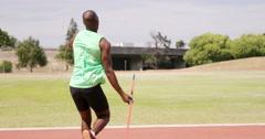 Sportsman doing javelin throw Stock Footage