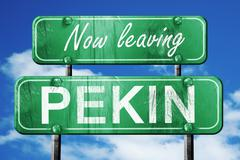 Leaving pekin, green vintage road sign with rough lettering Stock Illustration
