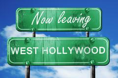 Leaving west hollywood, green vintage road sign with rough lette - stock illustration