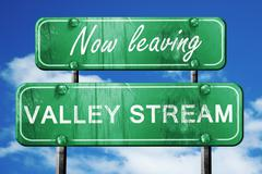 Leaving valley stream, green vintage road sign with rough letter - stock illustration