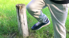 The strong man strike off tree stump with one hit of leg. Slowly Stock Footage