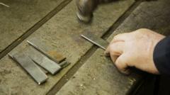 Steel hammer on metal plate Stock Footage
