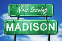 Leaving madison, green vintage road sign with rough lettering - stock illustration