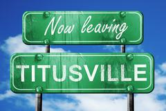 Stock Illustration of Leaving titusville, green vintage road sign with rough lettering