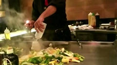 Professional Chief cooking vegtables / food in Kitchen Stock Footage