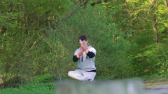 The performance of Wing Chun by man on forest background. Slowly Stock Footage