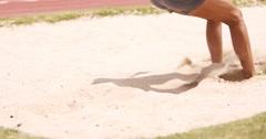 Sportswoman doing long jump Stock Footage